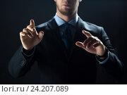 close up of businessman touching virtual screen, фото № 24207089, снято 6 сентября 2016 г. (c) Syda Productions / Фотобанк Лори
