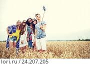 Купить «hippie friends with smartphone on selfie stick», фото № 24207205, снято 27 августа 2015 г. (c) Syda Productions / Фотобанк Лори