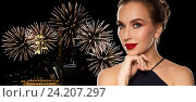 beautiful woman in black over firework lights. Стоковое фото, фотограф Syda Productions / Фотобанк Лори