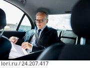Купить «senior businessman with papers driving in car», фото № 24207417, снято 16 июля 2016 г. (c) Syda Productions / Фотобанк Лори
