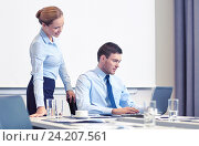 Купить «businessman and secretary with laptop in office», фото № 24207561, снято 25 октября 2014 г. (c) Syda Productions / Фотобанк Лори