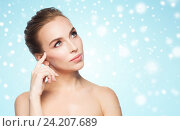 Купить «beautiful young woman touching her face over snow», фото № 24207689, снято 14 апреля 2016 г. (c) Syda Productions / Фотобанк Лори