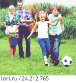 Купить «Cheerful family running with ball», фото № 24212765, снято 24 сентября 2018 г. (c) Яков Филимонов / Фотобанк Лори