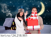 Купить «Happy couple holding stack of christmas gifts», фото № 24218901, снято 22 марта 2019 г. (c) Wavebreak Media / Фотобанк Лори