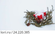 Купить «gift box and fir wreath with cones on snow», видеоролик № 24220385, снято 11 ноября 2016 г. (c) Syda Productions / Фотобанк Лори