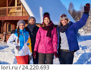 Best friends spend winter holidays at mountain cottage. Стоковое фото, фотограф Andrejs Pidjass / Фотобанк Лори