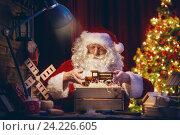 Купить «Santa Clause is preparing gifts», фото № 24226605, снято 8 ноября 2016 г. (c) Константин Юганов / Фотобанк Лори
