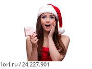 Купить «Young santa girl in christmas concept isolated on white», фото № 24227901, снято 3 октября 2016 г. (c) Elnur / Фотобанк Лори