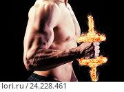 Купить «Muscular ripped bodybuilder with burning dumbbells», фото № 24228461, снято 14 мая 2015 г. (c) Elnur / Фотобанк Лори
