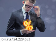 Купить «Businessman with percent sign in high interest concept», фото № 24228653, снято 8 июля 2016 г. (c) Elnur / Фотобанк Лори