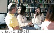 Купить «Young people listening to a lecture», видеоролик № 24229593, снято 18 августа 2016 г. (c) Raev Denis / Фотобанк Лори