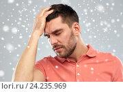 Купить «unhappy man suffering from head ache over snow», фото № 24235969, снято 15 января 2016 г. (c) Syda Productions / Фотобанк Лори