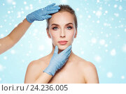Купить «surgeon or beautician hands touching woman face», фото № 24236005, снято 14 апреля 2016 г. (c) Syda Productions / Фотобанк Лори
