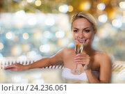 Купить «happy woman drinking champagne at swimming pool», фото № 24236061, снято 15 декабря 2014 г. (c) Syda Productions / Фотобанк Лори
