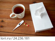 Купить «cup of tea, paper wipes and thermometer with pills», фото № 24236181, снято 13 октября 2016 г. (c) Syda Productions / Фотобанк Лори