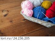 Купить «basket with knitting needles and balls of yarn», фото № 24236205, снято 20 октября 2016 г. (c) Syda Productions / Фотобанк Лори
