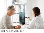 Купить «doctor with spine x-ray and senior man at hospital», фото № 24236497, снято 7 июля 2016 г. (c) Syda Productions / Фотобанк Лори