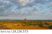 Купить «Утренний пейзаж с храмами в Багане», видеоролик № 24236573, снято 10 ноября 2016 г. (c) Михаил Коханчиков / Фотобанк Лори