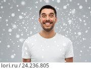 Купить «man with funny face over snow», фото № 24236805, снято 15 января 2016 г. (c) Syda Productions / Фотобанк Лори