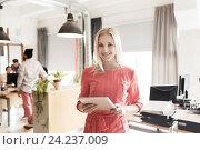 Купить «happy creative female office worker with tablet pc», фото № 24237009, снято 29 марта 2015 г. (c) Syda Productions / Фотобанк Лори