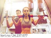 Купить «man and woman with barbell flexing muscles in gym», фото № 24237077, снято 30 ноября 2014 г. (c) Syda Productions / Фотобанк Лори