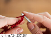 Купить «close up of hands knitting with crochet hook», фото № 24237281, снято 20 октября 2016 г. (c) Syda Productions / Фотобанк Лори