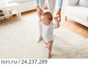 Купить «happy baby learning to walk with mother help», фото № 24237289, снято 12 июля 2016 г. (c) Syda Productions / Фотобанк Лори