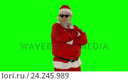Santa claus posing with sunglasses. Стоковое видео, агентство Wavebreak Media / Фотобанк Лори