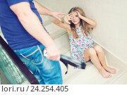 Купить «Испуганная маленькая девочка плачет, сидя на лестнице и ее отец с ремнем. Домашнее насилие», фото № 24254405, снято 23 октября 2016 г. (c) Наталья Дексбах / Фотобанк Лори