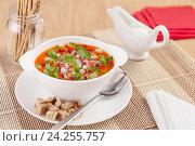 Купить «Холодный суп гаспачо в белой миске на столе», фото № 24255757, снято 12 октября 2016 г. (c) Анастасия Богатова / Фотобанк Лори