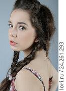 Купить «Портрет молодой симпатичной девушки с длинными темными волосами, заплетенными в косы.», фото № 24261293, снято 25 марта 2019 г. (c) Olesya Tseytlin / Фотобанк Лори