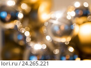 Купить «golden christmas decoration or garland of beads», фото № 24265221, снято 3 ноября 2016 г. (c) Syda Productions / Фотобанк Лори