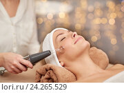 Купить «close up of young woman having face massage in spa», фото № 24265529, снято 18 декабря 2014 г. (c) Syda Productions / Фотобанк Лори