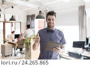 Купить «happy creative male office worker with tablet pc», фото № 24265865, снято 29 марта 2015 г. (c) Syda Productions / Фотобанк Лори