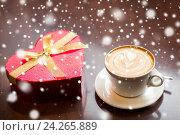 Купить «close up of gift box and coffee cup on table», фото № 24265889, снято 1 декабря 2015 г. (c) Syda Productions / Фотобанк Лори