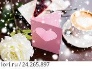 Купить «close up of greeting card with heart and coffee», фото № 24265897, снято 1 декабря 2015 г. (c) Syda Productions / Фотобанк Лори