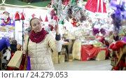 Купить «female customer near counter with Christmas gifts», видеоролик № 24279053, снято 2 декабря 2015 г. (c) Яков Филимонов / Фотобанк Лори
