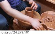 Купить «male potter working with clay on pottery wheel», видеоролик № 24279101, снято 23 июня 2016 г. (c) Яков Филимонов / Фотобанк Лори
