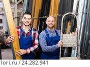 Купить «Two smiling workmen at factory», фото № 24282941, снято 18 октября 2018 г. (c) Яков Филимонов / Фотобанк Лори