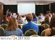 Купить «Аудитория в лекционном зале на бизнес-конференции», фото № 24287933, снято 17 августа 2019 г. (c) Matej Kastelic / Фотобанк Лори