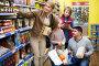 Family buying groceries in supermarket, фото № 24296653, снято 1 декабря 2016 г. (c) Яков Филимонов / Фотобанк Лори