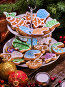 Christmas cookies on Tiered Cookie Stand under fir branches., фото № 24300013, снято 30 ноября 2016 г. (c) Gennadiy Poznyakov / Фотобанк Лори