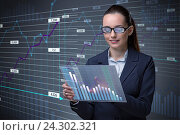 Купить «Businesswoman in online stock trading business concept», фото № 24302321, снято 24 октября 2016 г. (c) Elnur / Фотобанк Лори