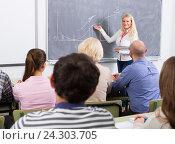 Купить «Adult students with teacher in classroom», фото № 24303705, снято 20 апреля 2018 г. (c) Яков Филимонов / Фотобанк Лори