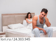 Купить «Family conflict with wife and husband in bed», фото № 24303945, снято 12 октября 2016 г. (c) Elnur / Фотобанк Лори