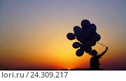 Купить «Running girl with balloons outdoors», видеоролик № 24309217, снято 10 декабря 2019 г. (c) Raev Denis / Фотобанк Лори