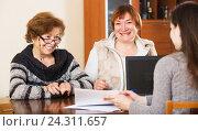 Купить «Three women with papers», фото № 24311657, снято 25 июня 2019 г. (c) Яков Филимонов / Фотобанк Лори