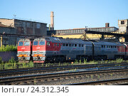 Купить «RYBINSK, RUSSIA - JULY 10, 2016: Two freight diesel locomotive 2TE116 locomotive depot train station Rybinsk», фото № 24312345, снято 10 июля 2016 г. (c) Виктор Карасев / Фотобанк Лори