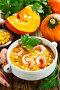 Тыквенный суп с креветками и консервированной кукурузой на обеденном столе, фото № 24315537, снято 28 ноября 2016 г. (c) Надежда Мишкова / Фотобанк Лори