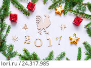 New Year 2017 background with 2017 figures,Christmas toys, fir tree branches and rooster - Concept of Happy New Year 2017 holiday, фото № 24317985, снято 30 ноября 2016 г. (c) Зезелина Марина / Фотобанк Лори